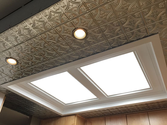Stamped ceiling tiles