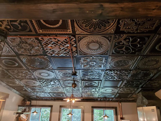 Multiple Faux Tin Ceiling Tiles installed in Kitchen